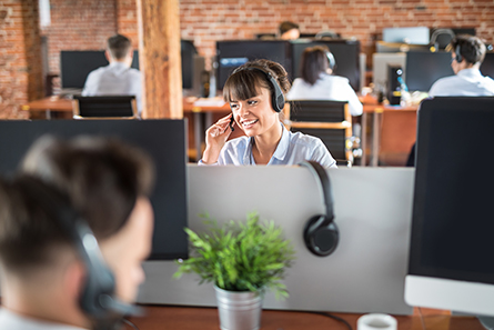 Smiling customer support operator at work.