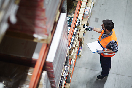 warehouse worker checking barcodes with scanner