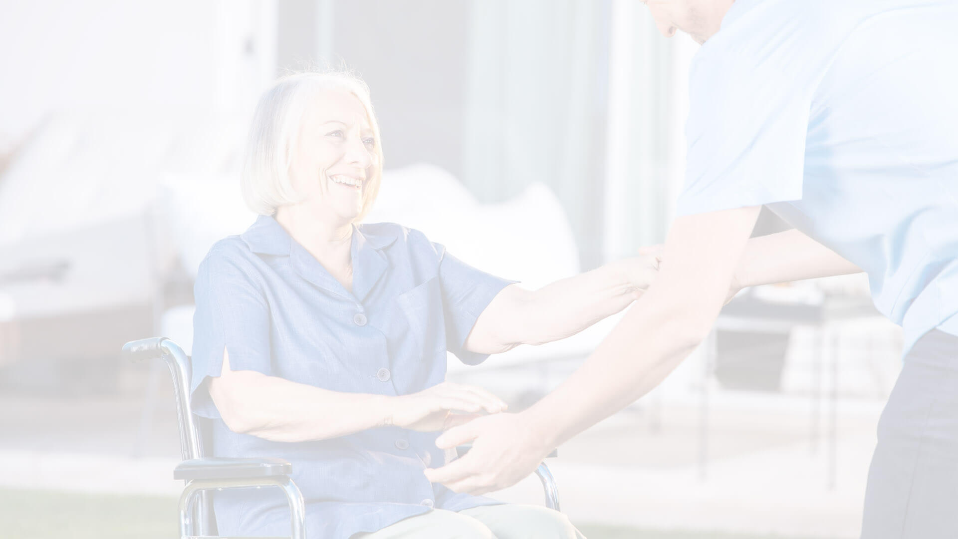 elderly lady in wheelchair being assisted
