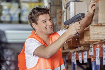 warehouse worker scanning items on the shelf with a handheld device
