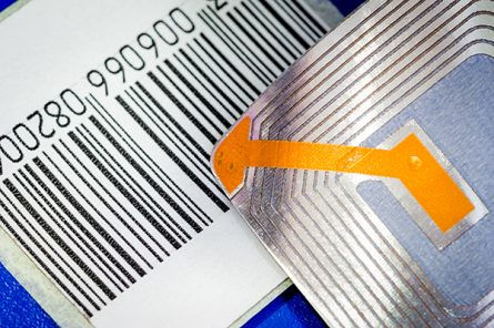 Close up of RFID tags ana a code bar used for tracking and ident